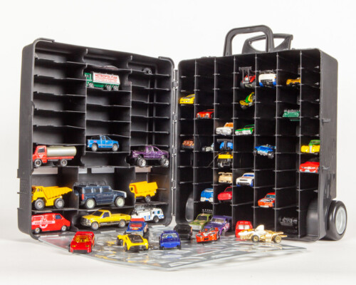 Hotwheels car carrier with several cars inside. Black plastic wheeled box.