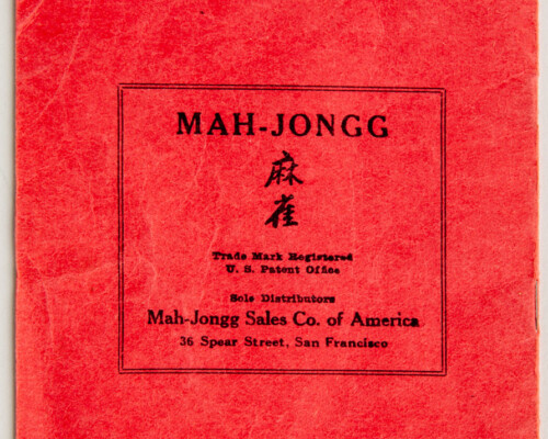 Mah-jongg rule book. Small red rule book with black text.