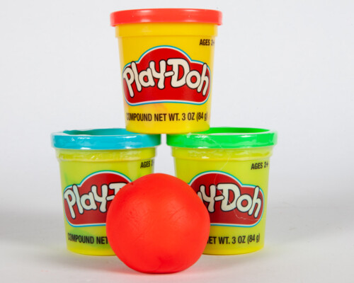 Red Play-Doh ball and three Play-Doh containers.