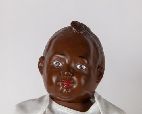 Close up of African American Nancy Newborn doll.