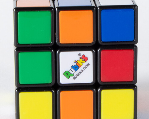Close up of Rubiks cube with scrambled colors.