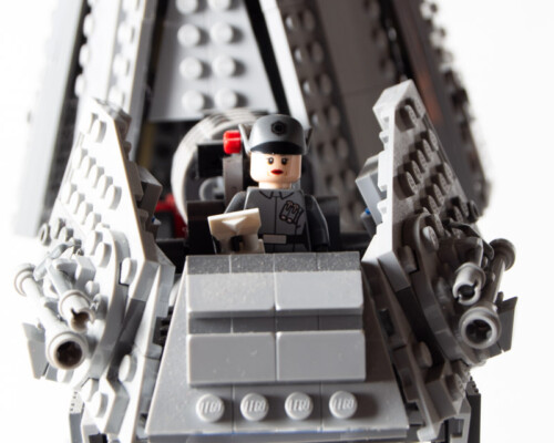 Close up of Lego Star Wars AT-AT pilot. Canopy is absent, pilot wears grey uniform.