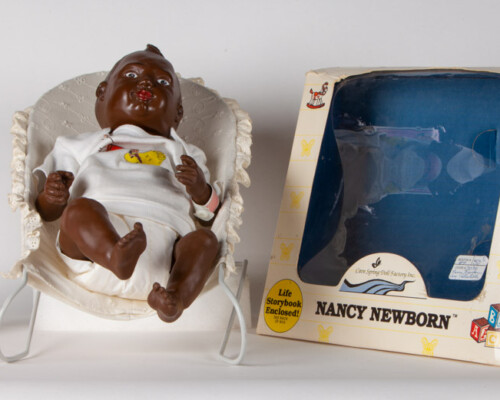 African American Nancy Newborn doll with baby seat, book, and original packaging.
