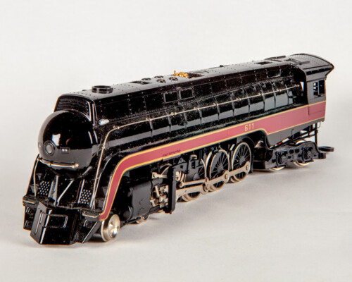 Black train engine with red and yellow trim.