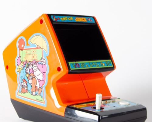 Donkey Kong Junior home console with game art piece on the shell.
