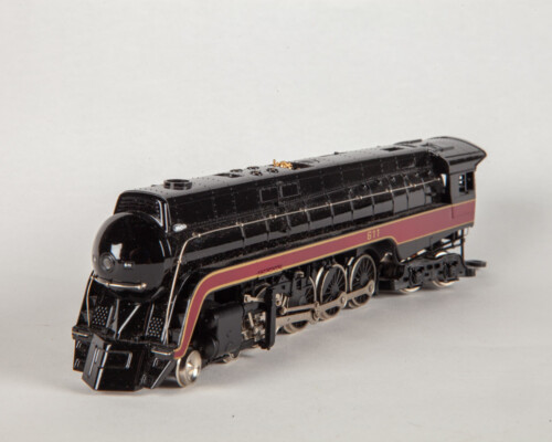 Front view of black and red train with gold and silver accents.