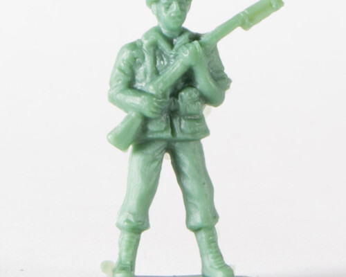Tan army man carrying a rifle.