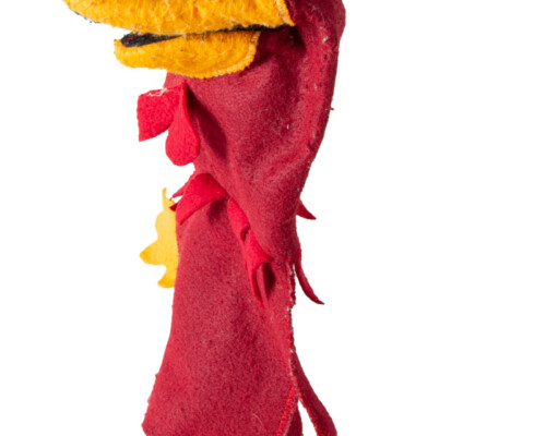 Side view of cocky hand puppet. Red and yellow felt with white eyes.