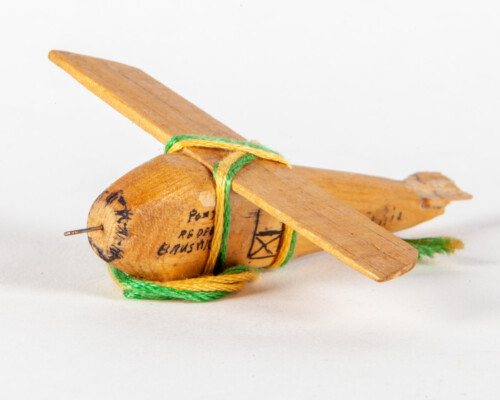 Hand carved wooden toy plane.
