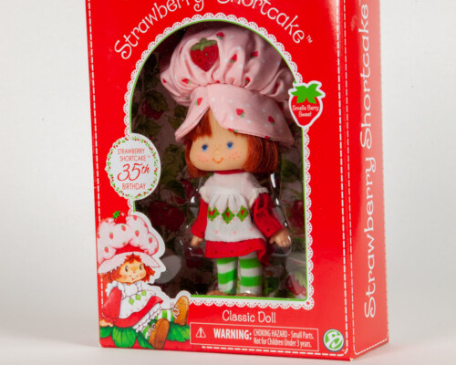 Strawberry Shortcake doll in box. Red box with white and green embellishment.