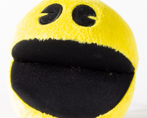 Pacman plush with its mouth open.