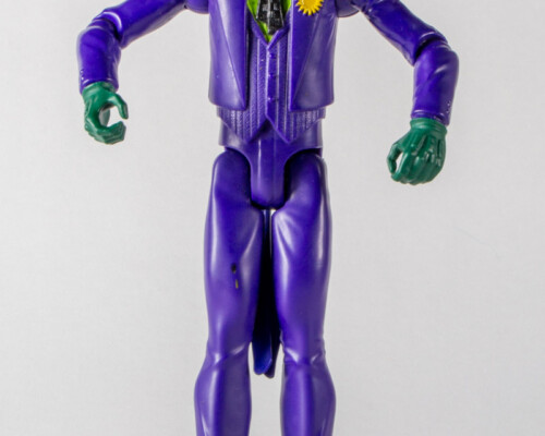 Front view of joker action figure. Purple suit and green shirt.