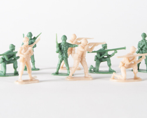 Green and tan army men, posed with rifles, bazookas, and radios.