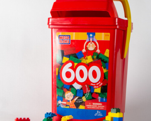 "Red ""Mega Bloks"" bulk package. Several small block creations sit below."