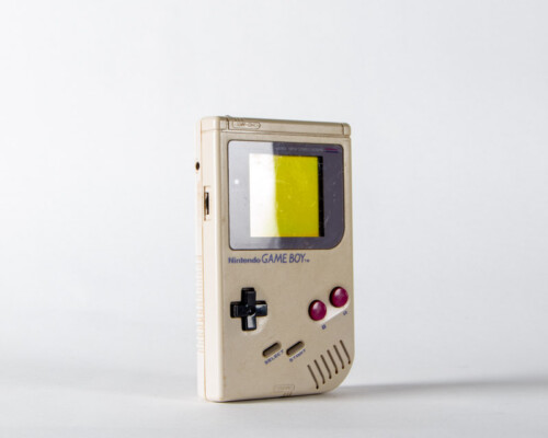 Nintendo Gameboy. Grey shell with black and red buttons.
