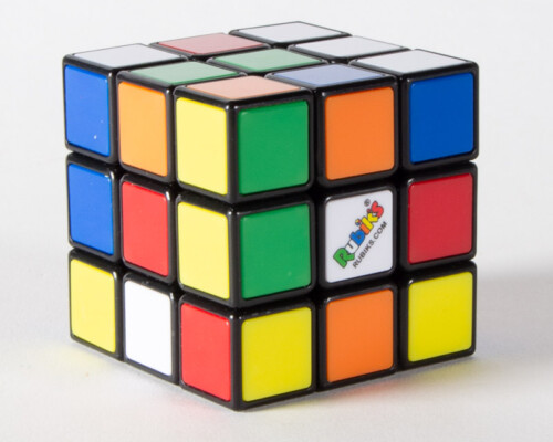Rubiks cube with scrambled colors.