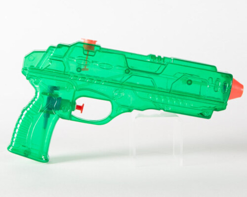 Clear green water pistol with red trigger and nozzle.