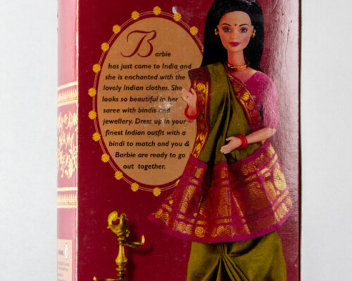 """Reverse of original """"Barbie in India"""" package. Doll inside has black hair red sari with blue and gold trim."""