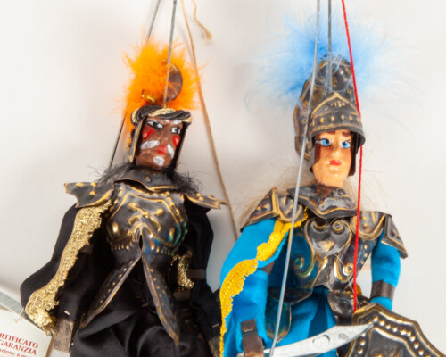 Close up of both marionette puppets.