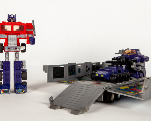 Optimus Prime transformed in to robot. Trailer unfolded showing robot and truck.