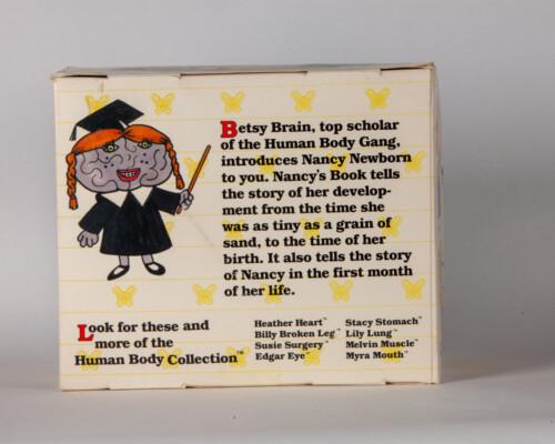 Reverse of Nancy Newborn packaging.