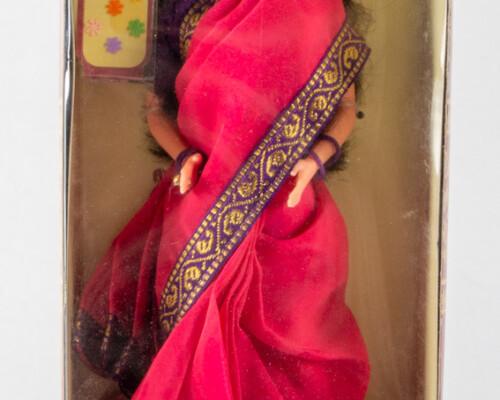 """Front of original """"Barbie in India"""" package. Doll inside has black hair red sari with blue and gold trim."""