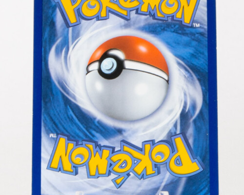 Reverse of Pokémon card. White and blue swirl pattern with yellow and blue text. Pokeball in the center.