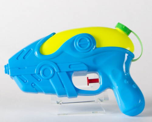 Blue and yellow water pistol with red trigger.