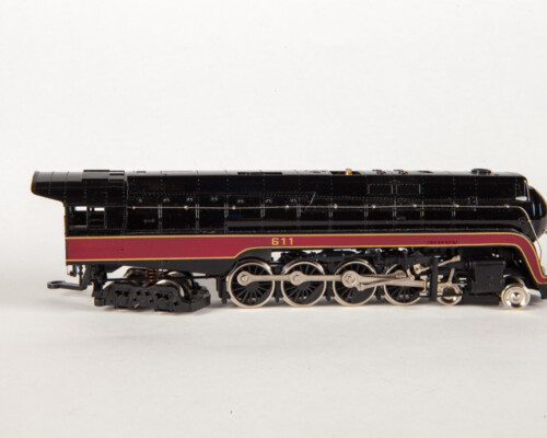 Side view of black and red train with gold and silver accents.