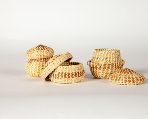 Three small sweetgrass baskets with lids.