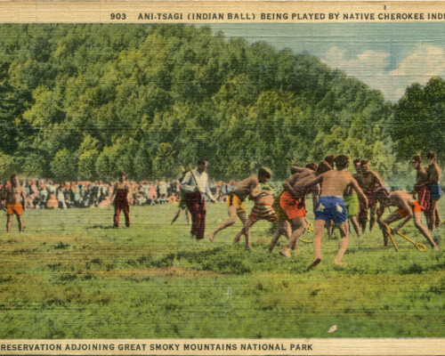 Image side of yellowing post card. Depicts Native Cherokee boys playing a game.