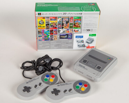 Reverse of Super Famicom classic console with two controllers and original packaging.